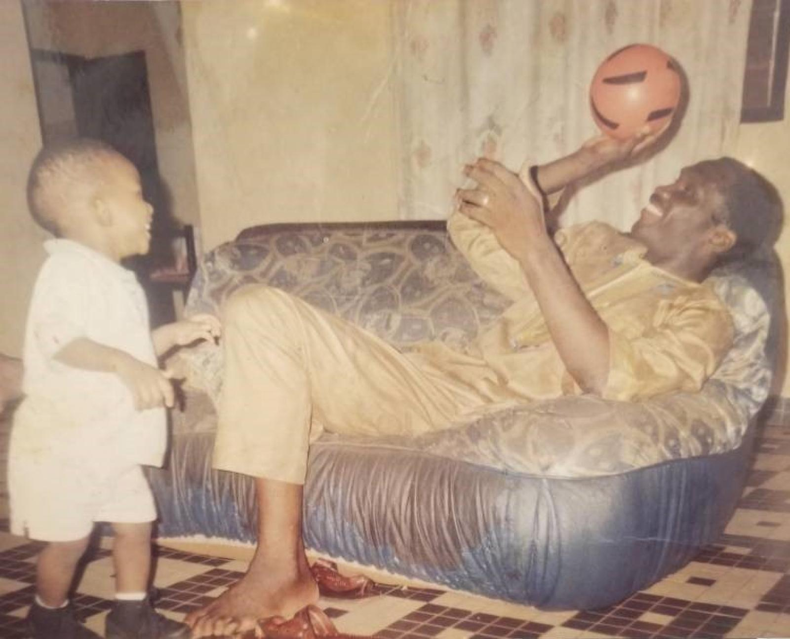 Joel playing with his father, Thomas Embiid