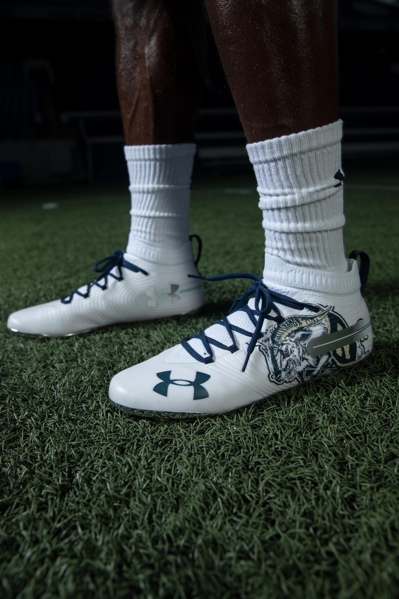 Bill the Goat also decorates the midshipmen's gloves and cleats.