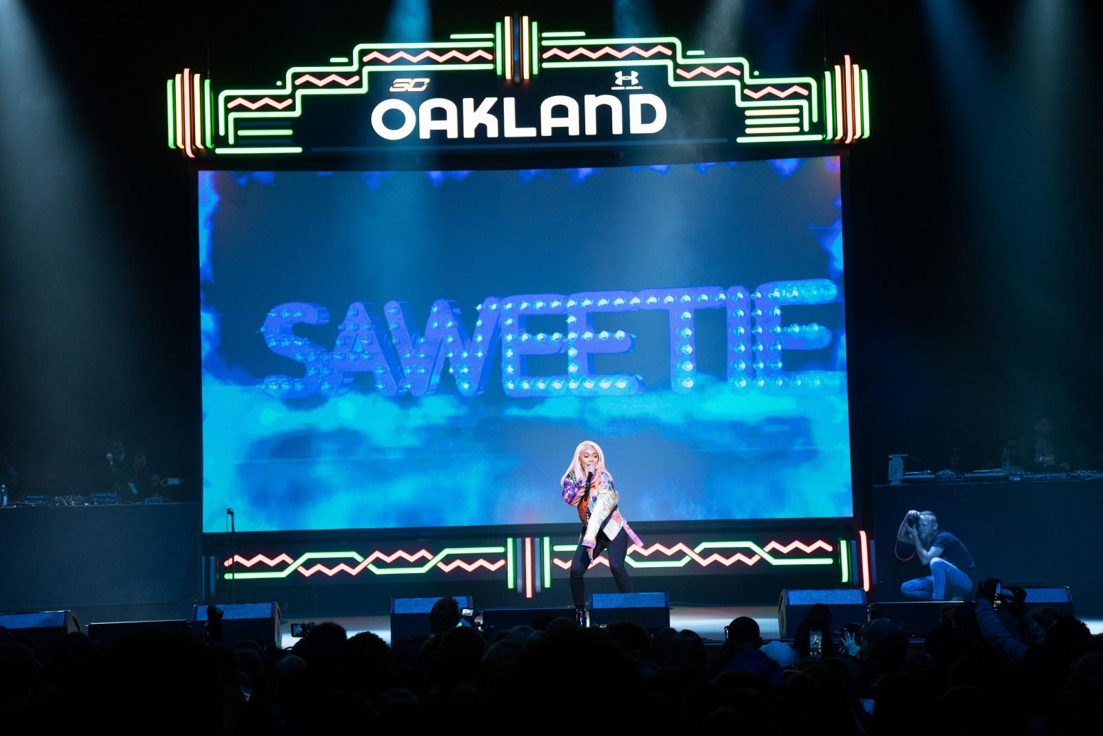 Saweetie performs on stage
