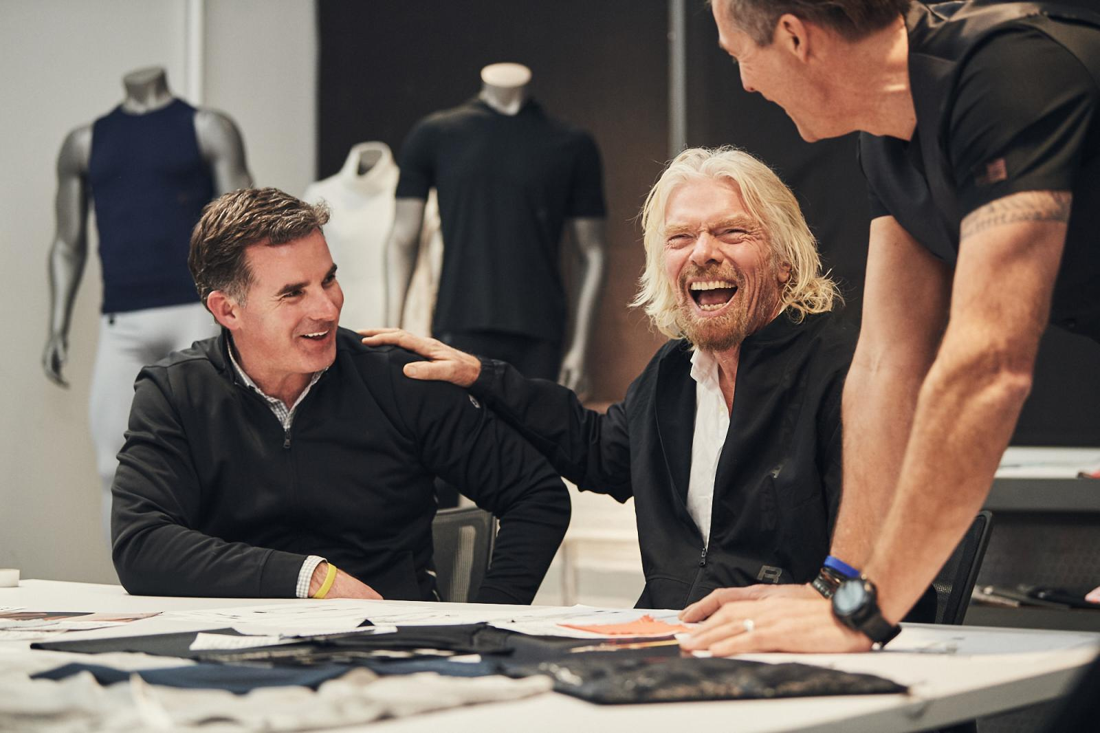 Under Armour's Kevin Plank and Sir Richard Branson of Virgin Galactic share a moment with UA's lead spacesuit designer Nick Cienski.