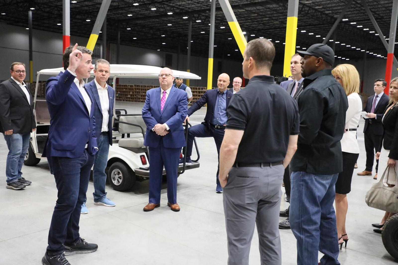CEO Kevin Plank and guests tour the ODH before the opening ceremony.