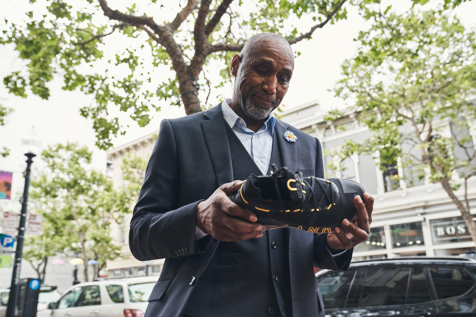 Ralph Walker, Stephen's now retired personal security guard, holds the Curry 6 Thank You, Oakland colorway.
