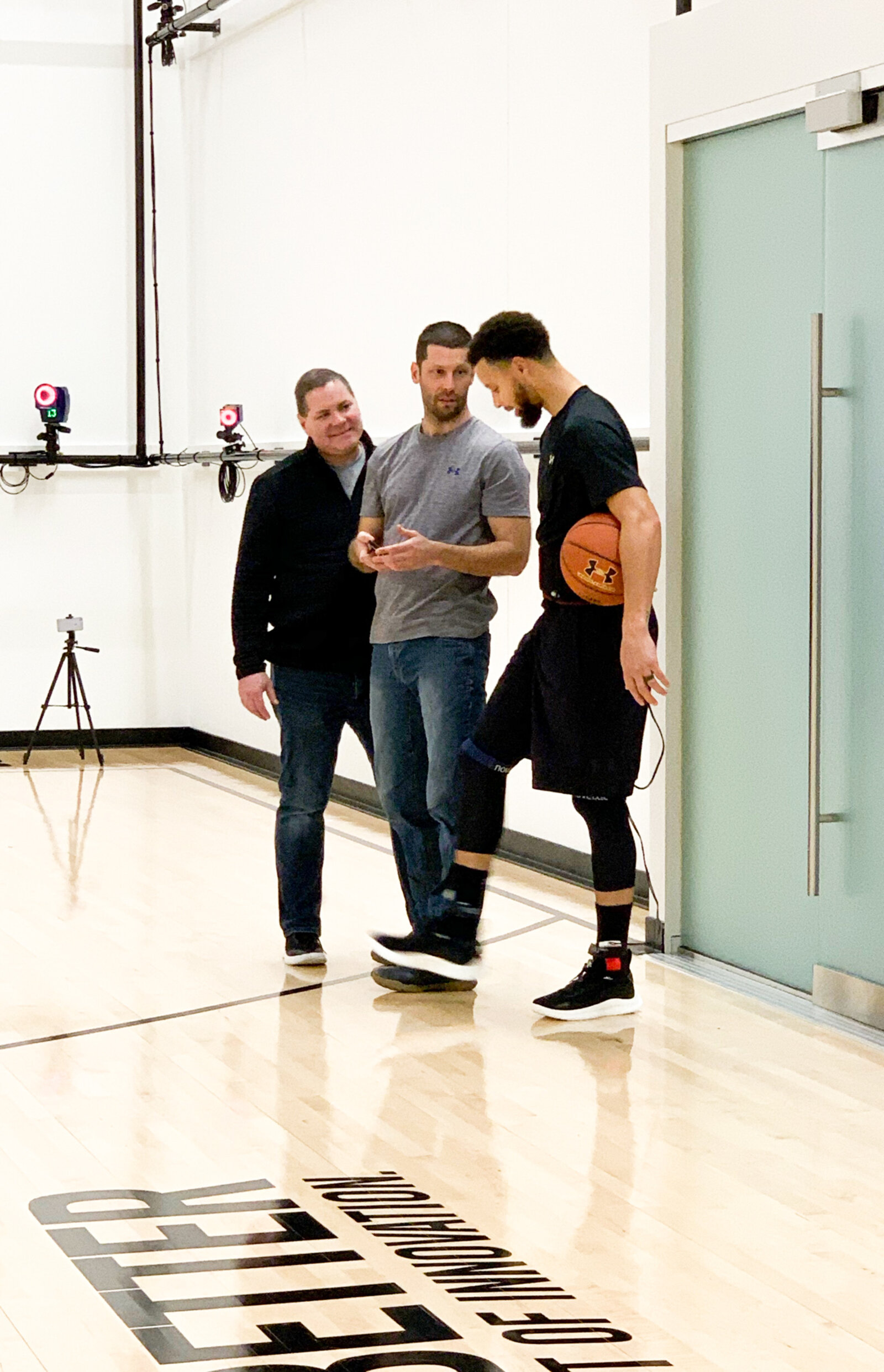 Fred Dojan (left), Tom Luedecke (center), and Stephen Curry in Under Armour's Biomechanics Lab in Portland in 2019.