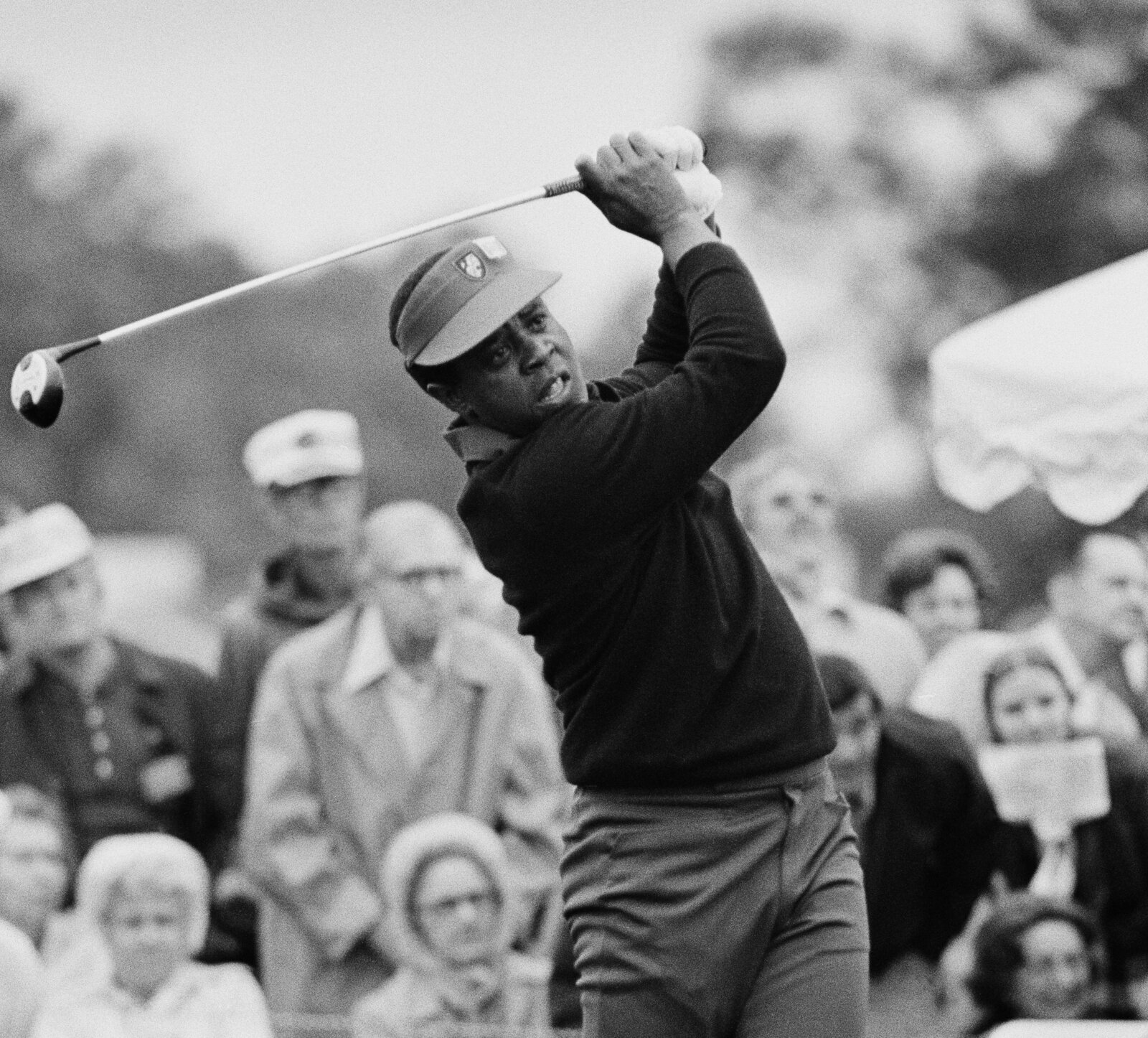 Lee Elder, the first Black player to qualify for and play in the Masters, tees off at the Augusta National Golf Club in April 1975.