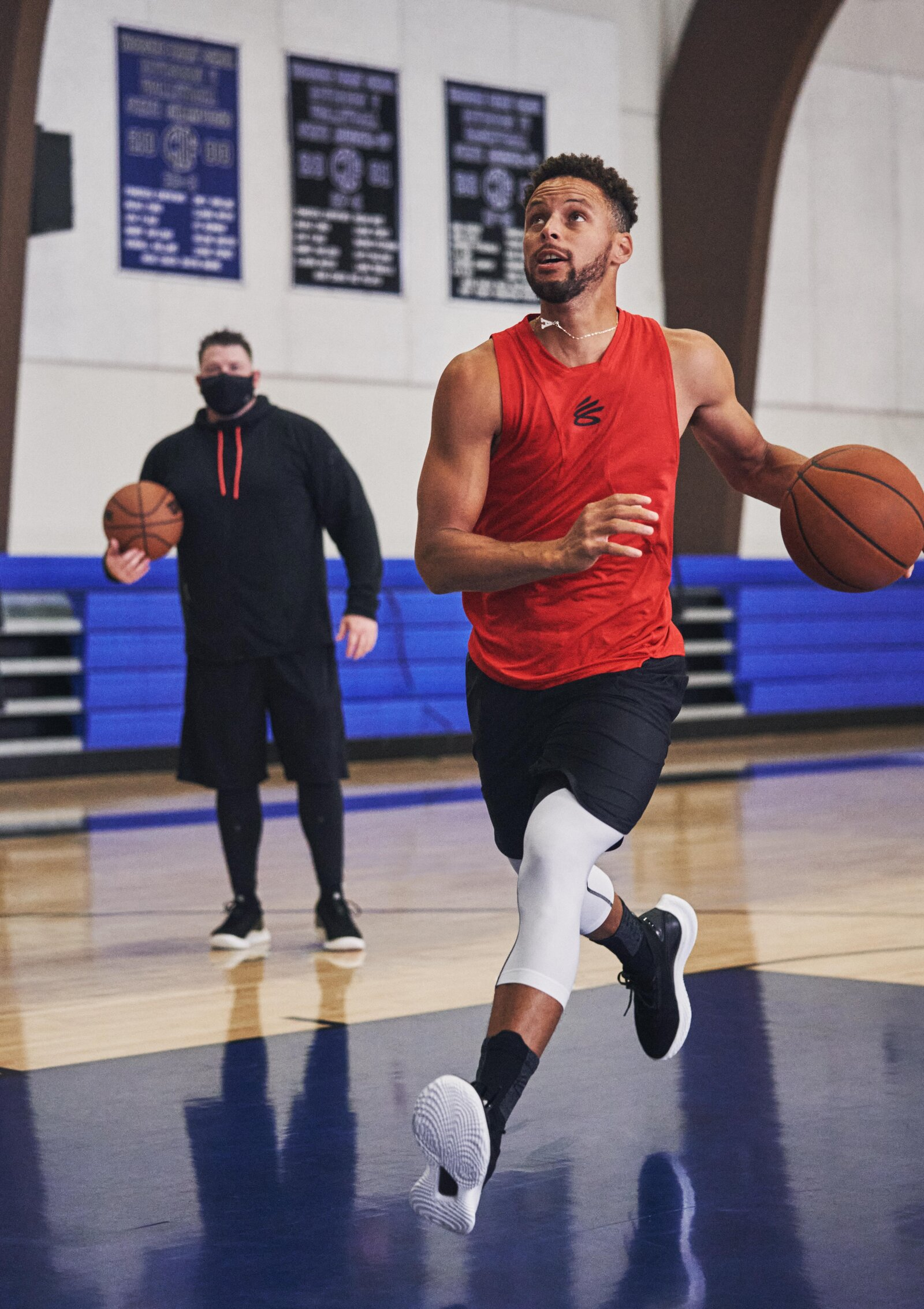 Curry has spent more than a decade refining his skills with trainer Brandon Payne (left).
