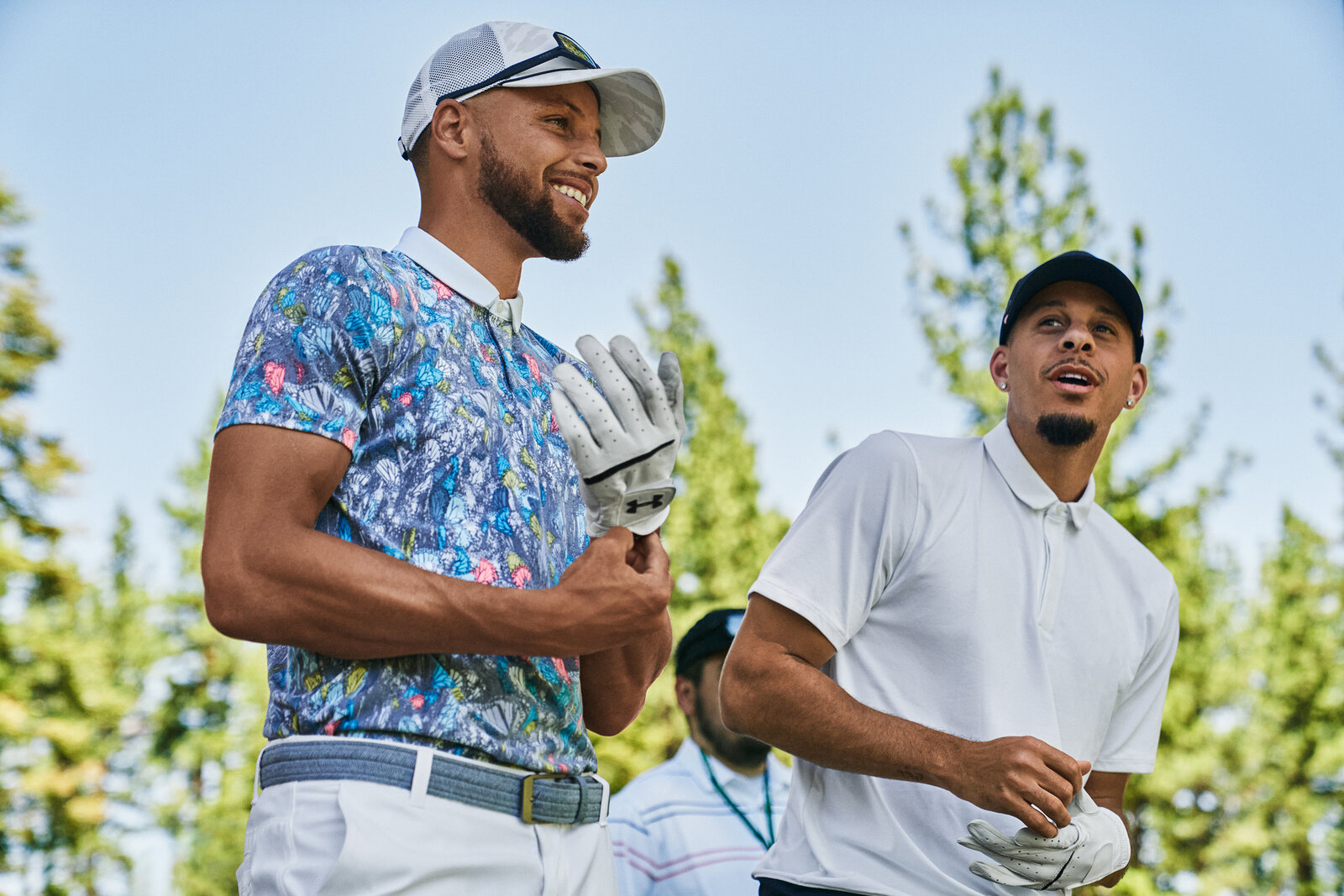 Stephen (left) hit the course with his brother Seth Curry (right) in the new Curry Brand golf collection.